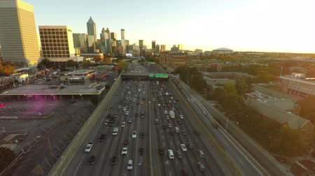 sunset city : v14. Atlanta cityscape aerial flying over freeway during sunset. 10914 Stock Footage