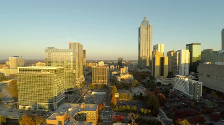 sunset city : v39. Low flying aerial betweem Atlanta buildings during sunset. 111214