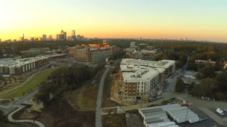 sunset city : v12. Atlanta city aerial flying over the Beltline during sunset. Stock Footage