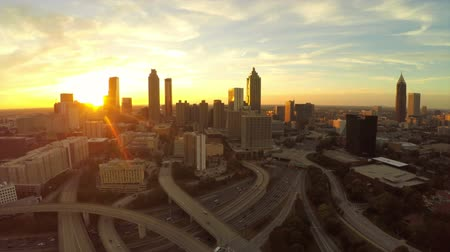 drone : v21. Atlanta aerial flying backwards with cityscape sunset view.