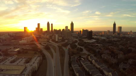 usa : v22. Atlanta aerial flying upwards with cityscape sunset view.