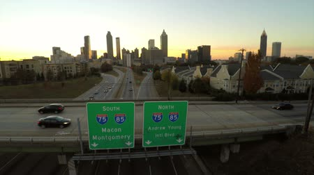 v28. Atlanta aerial flying over Freedom Parkway with cityscape sunset view.