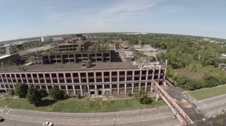abandoned old : v10. Low flying aerial over abandoned Packard Automotive Plant in Detroit. Stock Footage