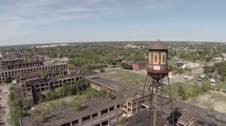 abandoned old : v12. Low flying aerial over abandoned Packard Automotive Plant around the water tower.