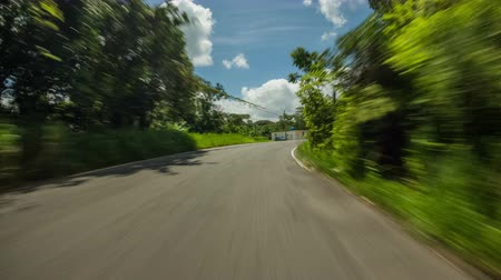 útkereszteződés : v104. Driving time lapse through Puerto Rico jungle hills. Stock mozgókép