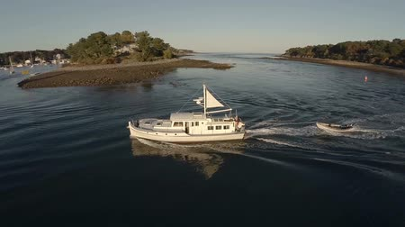 над : v11. Aerial fly around of fishing boat in York Harbor, Maine.