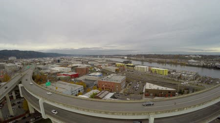 drone : v6. Low flying Portland aerial of industrial area and over freeway.