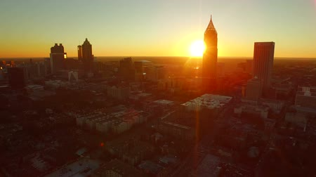 beautiful view : Atlanta Aerial Cityscape Sunset v46. Low flying Atlanta aerial into the city with cityscape sunset view. Stock Footage