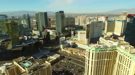 hilton : Las Vegas Aerial Cityscape Strip v5 Low flying backwards aerial over strip. 21815 Stock Footage