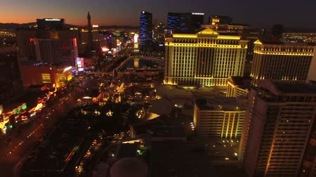 tiras : Las Vegas Aerial Cityscape Strip Dawn v21 Side view low flying aerial over strip. 21815 Stock Footage