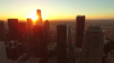 morning : Los Angeles Aerial Downtown Cityscape Sunrise v81 Rising aerial of downtown cityscape and over buildings. 22515 Stock Footage