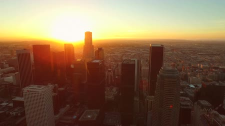 budynki : Los Angeles Aerial Downtown Cityscape Sunrise v82 Aerial over downtown buildings revealing cityscape view. 22515