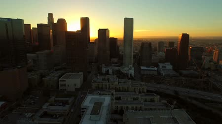 şafak : Los Angeles Aerial Downtown Cityscape Sunrise v83 Low flying aerial close to downtown with cityscape view. 22515