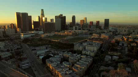 apartamentos : Los Angeles Aerial Downtown Cityscape Sunrise v86 Low flying aerial towards downtown with cityscape view.