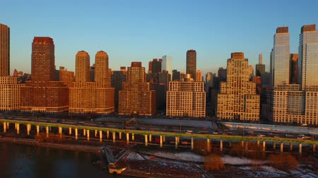 nyc : New York City Aerial v1 Low flying side view of Upper West Side Manhattan cityscape during sunset from waterfront. Stock Footage