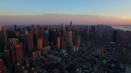 центральный : New York City Aerial v8 Panning right with view of Manhattan and New Jersey cityscapes at sunset.