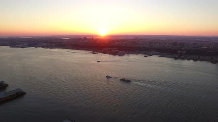 beautiful view : New York City Aerial v10 Panning right with view of Hudson River and New Jersey cityscapes at sunset.