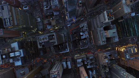 nyc : New York City Aerial v14 Vertical shot looking down over W 54th at 7th Ave and Broadway heading west just after sunset. Stock Footage