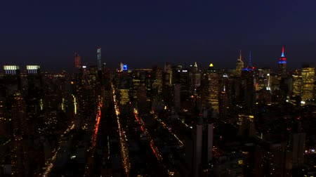 nyc : New York City Aerial v23 Panning left with view of complete Manhattan cityscape at nightdusk.