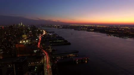 jam : New York City Aerial v24 Panning right with view of Manhattan and New Jersey cityscapes at dusk.