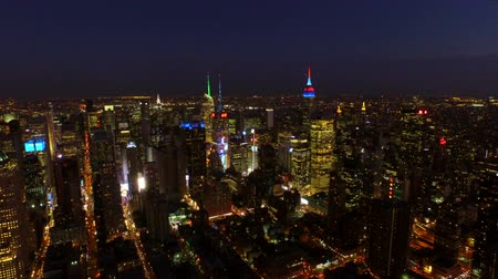üzerinde : New York City Aerial v25 Flying over Midtown Manhattan area toward Times Square at night. Stok Video