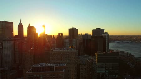 panorâmico : New York City Aerial v40 Low flying panning right with view of Manhattan Financial District cityscape and Governors Island at sunrise. Stock Footage