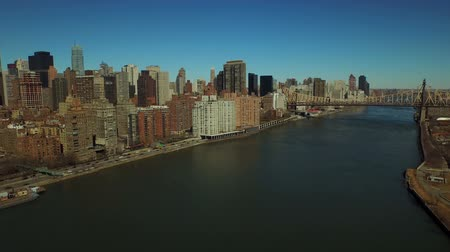 nyc : New York City Aerial v43 Low flying over East River panning left with view of Midtown East Manhattan cityscape.