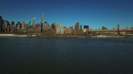 düşük : New York City Aerial v48 Low flying over East River panning left with view of Midtown East Manhattan cityscape.