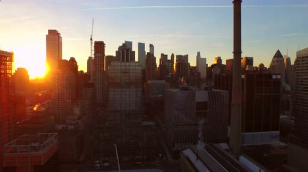центральный : New York City Aerial v84 Flying low into West Side Manhattan towards Midtown between buildings at sunrise.