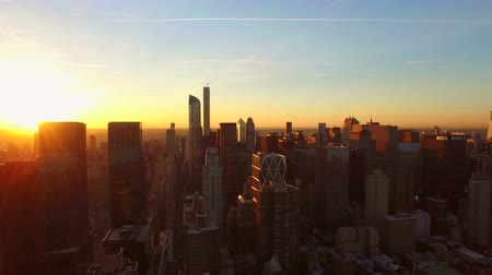 закат : New York City Aerial v85 Flying low over West Side Manhattan buildings towards Midtown at sunrise.