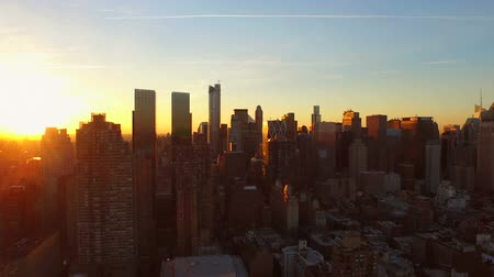 sunset city : New York City Aerial v87 Flying low into West Side Manhattan and over Midtown towards sunrise.