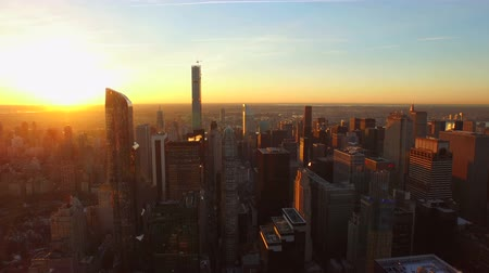 üzerinde : New York City Aerial v88 Flying low backwards over Midtown and West Side Manhattan at sunrise. Stok Video