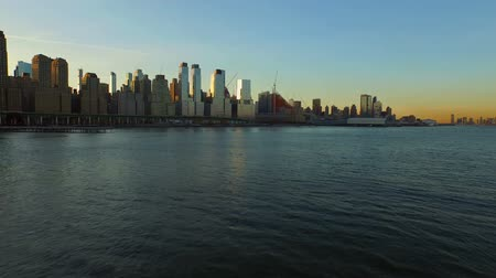 vozidla : New York City Aerial v93 Flying low over Hudson River panning left with Manhattan cityscape views at sunrise.