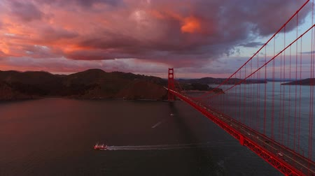 san francisco : San Francisco Aerial v3 Flying low besides the Golden Gate Bridge at sunset. Stock Footage