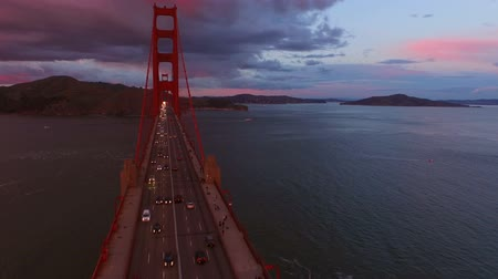 san francisco : San Francisco Aerial v7 Flying low over and besides the Golden Gate Bridge at sunset. Stock Footage