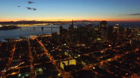 san francisco : San Francisco Aerial v13 Flying sideways over downtown at dawn.