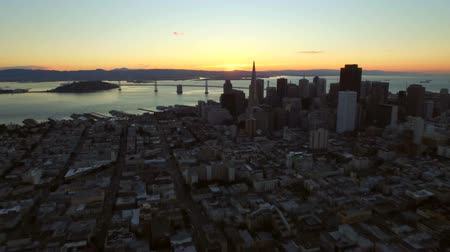 san francisco : San Francisco Aerial v18 Flying low over downtown at sunrise.