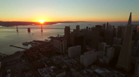 san francisco : San Francisco Aerial v21 Flying low with side backwards view of downtown at sunrise. Stock Footage