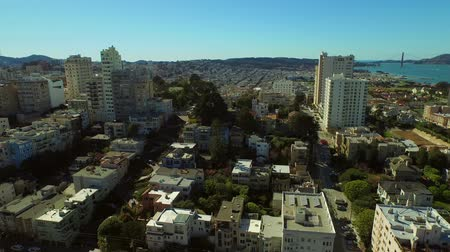 san francisco : San Francisco Aerial v48 Flying low backwards over Russian Hill with view of Lombard Street.