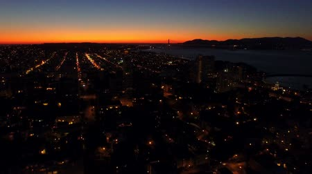 bay bridge : San Francisco Aerial v58 Flying low backwards over Russian Hill and Telegraph Hill after sunset.