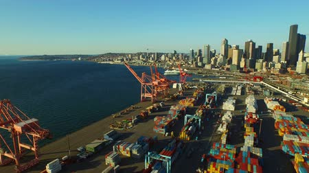 truck crane : Seattle Aerial v1 Flying low over large shipyard port with cityscape and waterfront views.