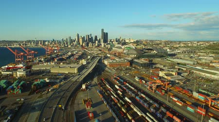 yards : Seattle Aerial v7 Flying low backwards panning right over industrial area with cityscape views. Stock Footage
