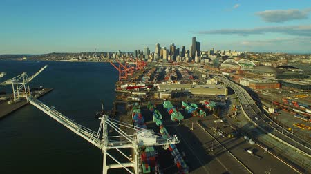 truck crane : Seattle Aerial v9 Flying low over large shipyard ports towards citycenter.