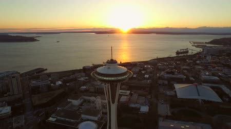 арена : Seattle Aerial v18 Flying backwards low over Space Needle at sunset.