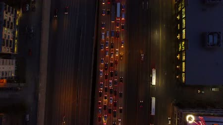 вниз : Seattle Aerial v34 Flying low vertical shot looking down over freeway at dusk.