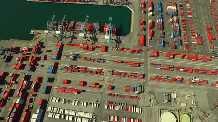 truck crane : Shipyard Aerial v11 Flying vertical shot looking down over large commercial shipyard and ships. Stock Footage