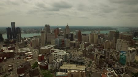 motor vehicle : Detroit Aerial v20 Flying over downtown panning left slowly with cityscape views.