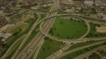 motor vehicle : Detroit Aerial v55 Flying low over Interstate 94 and 75 intersection panning down to vertical shot.