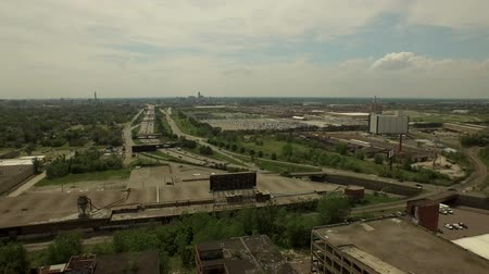 abandoned old : Detroit Aerial v58 Flying low over abandoned old Packard Plant panning left with cityscape views.