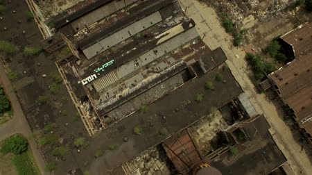 motor vehicle : Detroit Aerial v60 Flying vertical shot looking down over abandoned old Packard Plant.